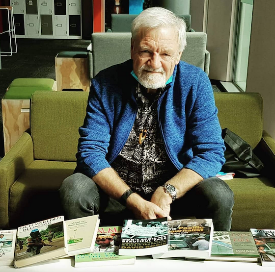 Dr David Robie with books produced at PMC during his 13-year tenure (Laurens Ikinia)