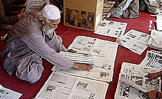 Hand-compiling the Kabul Weekly newspaper (Martin Hadlow)